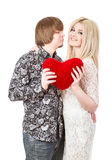 Happy couple kissing and holding red valentine's heart Royalty Free Stock Image