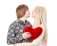 Happy couple kissing and holding red valentine's heart Royalty Free Stock Images