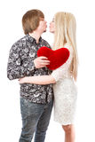 Happy couple kissing and holding red valentine's heart Stock Photo