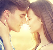 Happy couple kissing and hugging outdoors Royalty Free Stock Photos