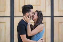 Happy couple kissing outside. Portrait of happy couple kissing outside Royalty Free Stock Photography