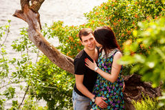 Happy couple kissing at the river. Happy couple near the river in summer Royalty Free Stock Photography