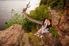 Happy couple kissing at the river. Happy couple near the river in summer Royalty Free Stock Image