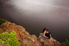 Happy couple kissing at the river. Happy couple near the river in summer Stock Photo