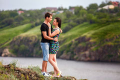 Happy couple kissing at the river Royalty Free Stock Image