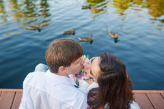 Happy couple kissing in summer near lake Royalty Free Stock Photo