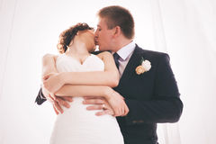 Happy couple kissing in sunlight Stock Photos