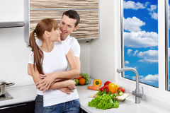 Happy couple at kitchen Stock Photography