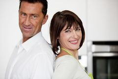 Happy Couple In The Kitchen Stock Photography