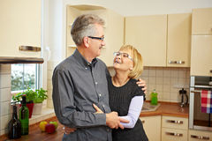 Happy couple in kitchen Royalty Free Stock Photo