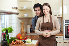 Happy couple in kitchen Stock Photography
