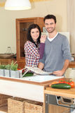 Happy couple in the kitchen Royalty Free Stock Images