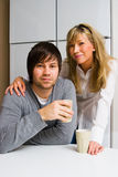 Happy couple in kitchen Stock Image