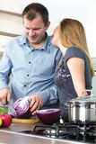 Happy couple in the kitchen preparing meals husband Royalty Free Stock Photography
