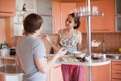Happy couple in kitchen Royalty Free Stock Image