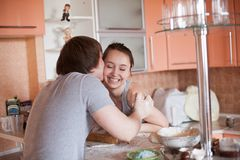 Happy couple in kitchen Royalty Free Stock Photos