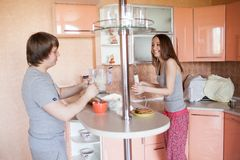 Happy couple in kitchen Royalty Free Stock Images