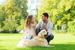 Happy couple with labrador dog walking in city Royalty Free Stock Photography