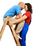 Happy couple on the ladder Royalty Free Stock Photography