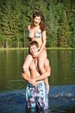 Happy couple in lake Stock Photo