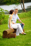 Happy couple on a lake Royalty Free Stock Images