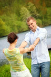 Happy couple on a lake Stock Photography