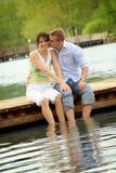 Happy couple on a lake stock photos