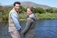 Happy couple at a lake Stock Photos