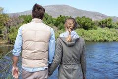 Happy couple at a lake Royalty Free Stock Photos