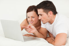Happy couple with a laptop Stock Image