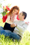 Happy couple with laptop Stock Photos