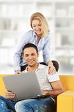 Happy couple with laptop computer Royalty Free Stock Photo