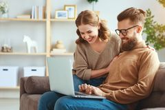 Happy couple with laptop computer at home royalty free stock image
