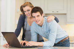 Happy couple on laptop Royalty Free Stock Photos