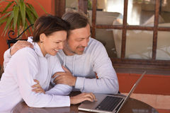 Happy couple with laptop Stock Photos