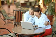Happy couple with laptop Stock Images
