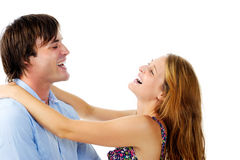 Happy couple laugh in each others arms Stock Photos