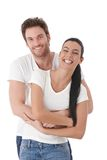 Happy couple laughing. Happy couple standing over white background, laughing stock photos