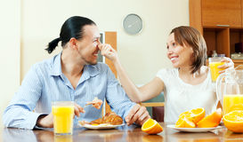 Happy couple laughing in breakfast time Stock Photography