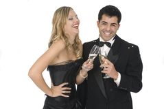 Happy couple laughing in a celebration party. Isolated Royalty Free Stock Photography