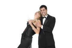 Happy couple laughing in a celebration party. Isolated Royalty Free Stock Photos