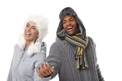 Happy couple laughing hand in hand Stock Photography