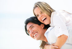 Happy couple laughing outdoors Royalty Free Stock Photo