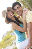 Happy couple laughing outdoors. A happy couple outdoors in casual clothing Royalty Free Stock Images