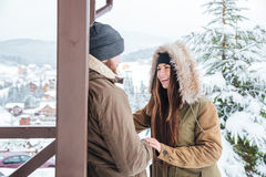 Happy couple laughing outdoors in winter Stock Photos