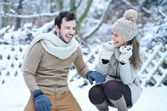 Happy couple laughing in snow Stock Images
