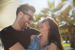 Happy couple laughing together standing outside. Close up portrait of happy couple laughing together standing outside Royalty Free Stock Image