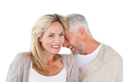Happy couple laughing together woman looking at camera. Happy couple laughing together women looking at camera on white background Royalty Free Stock Images