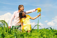 Happy couple on a lawn. Happy couple on a summer lawn Royalty Free Stock Photography