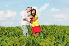 Happy couple on a lawn. Happy couple on a summer lawn Royalty Free Stock Photo